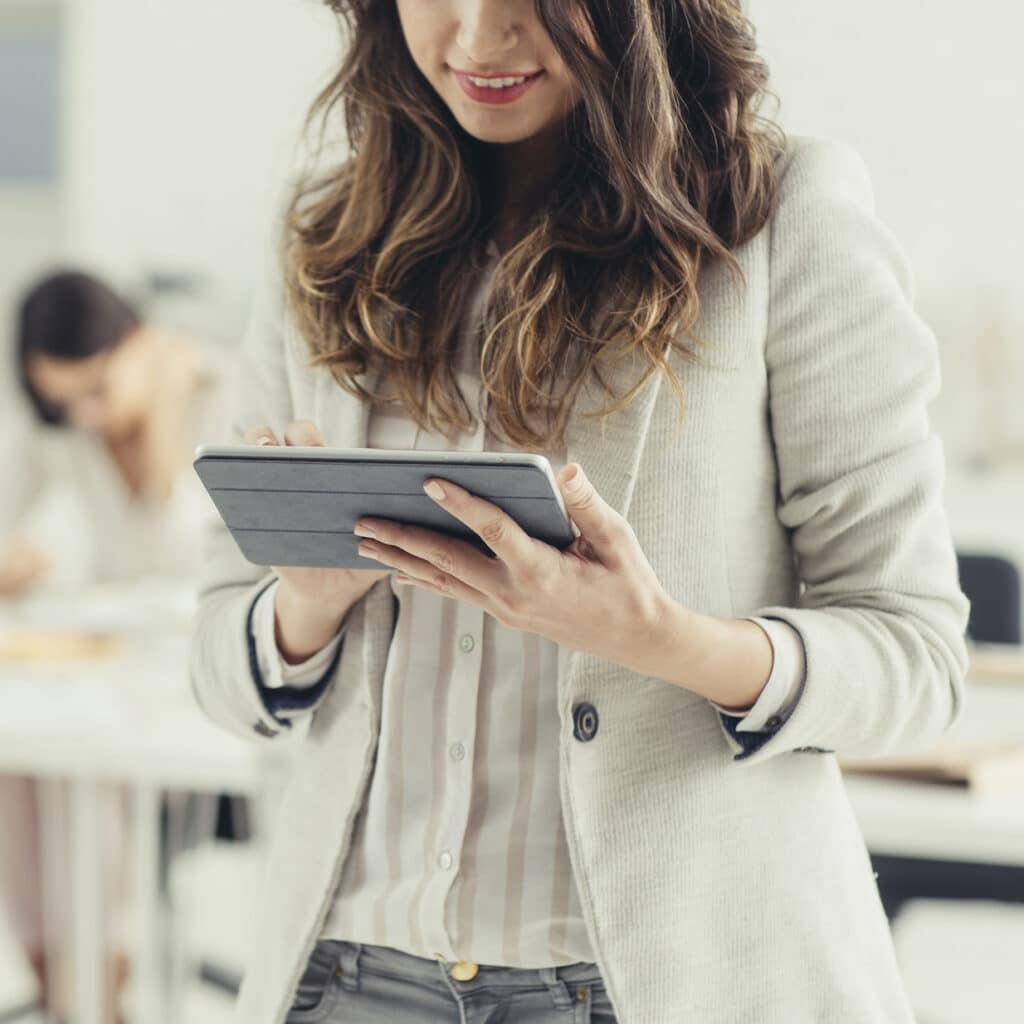Businesswoman using tablet in office.